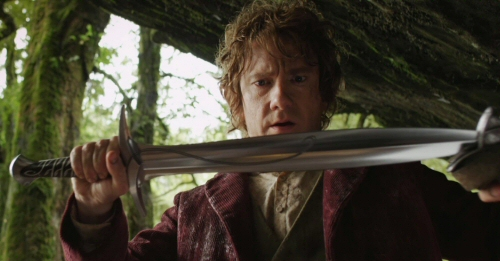 Martin Freeman as Bilbo Baggins, holding Sting, from The Hobbit: An Unexpected Journey